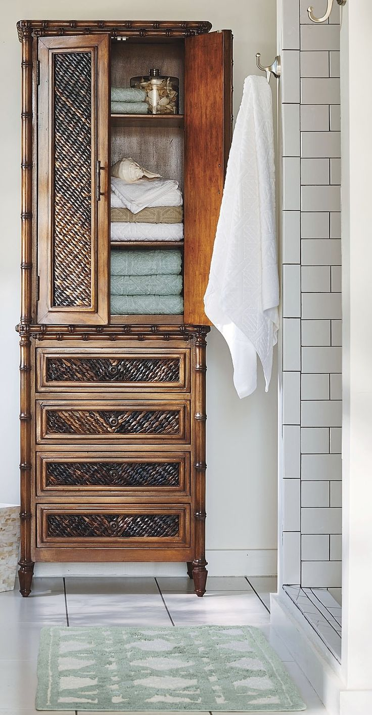 With its bamboo-inspired detailing and woven front panels, our Landon Bath Cabinet brings a touch of the tropics to your upscale bathroom.