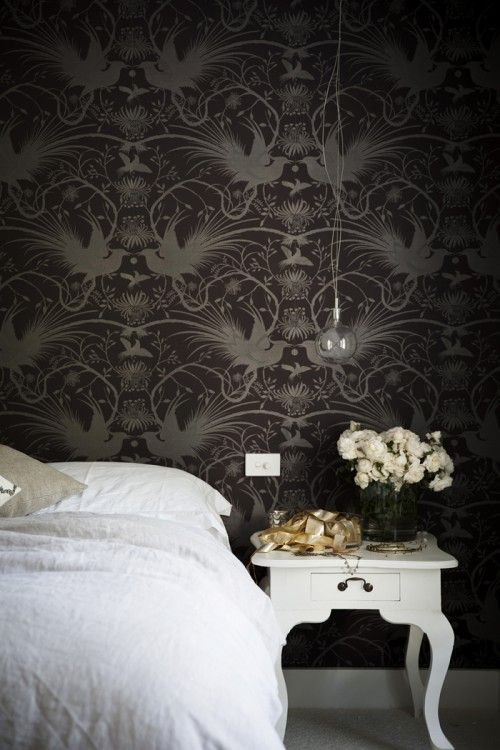 A moody dark wallpapered wall