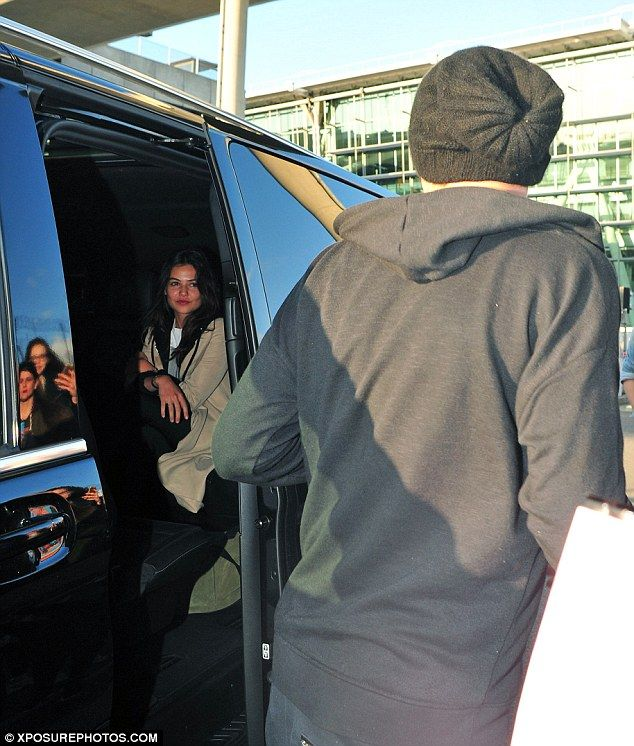 The best girlfriend ever? Danielle Campbell didn't even bat an eyelid as Louis Tomlinson jumped out of their car to take a group selfie with a flurry of female admirers as the couple touched down at London's Heathrow airport on Wednesday