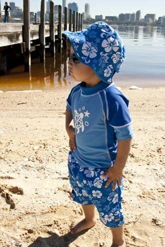 Protected from the harsh sun in Banz Coastline Blue swimwear pieces.
