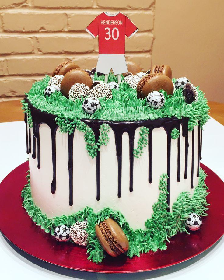 Soccer cake with black drip and green grass by @PettyCake