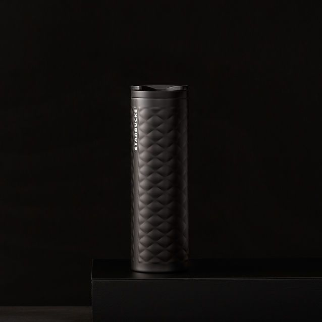 A+slender+stainless+steel+coffee+tumbler+with+a+smooth+quilted+texture+and+black+finish.