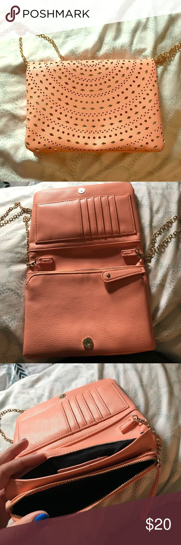 """Coral and gold purse Coral and gold purse with a gold chain to make it cross body. The chain can come off as well. Opens up and has a built in wallet on one side and two pockets on the other side and one of those zip. About 8"""" X 6"""". Was from Franchesca's and only used once Bags Crossbody Bags"""