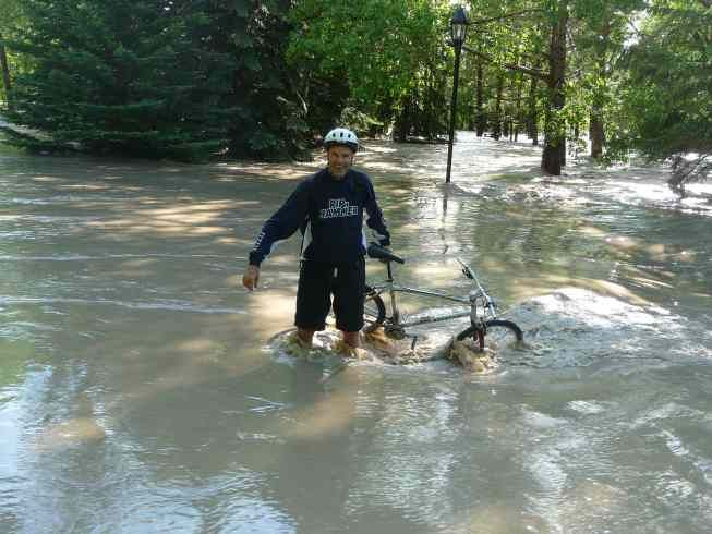 Here is Robert on a bike trail but the water is rushing so strongly where there is not supposed to be water!