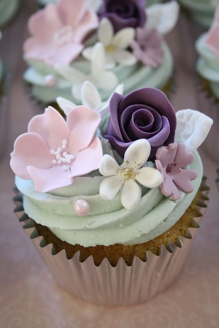 pastel flowers on a vanilla #cupcake with mint green frosting. #Spring #wedding