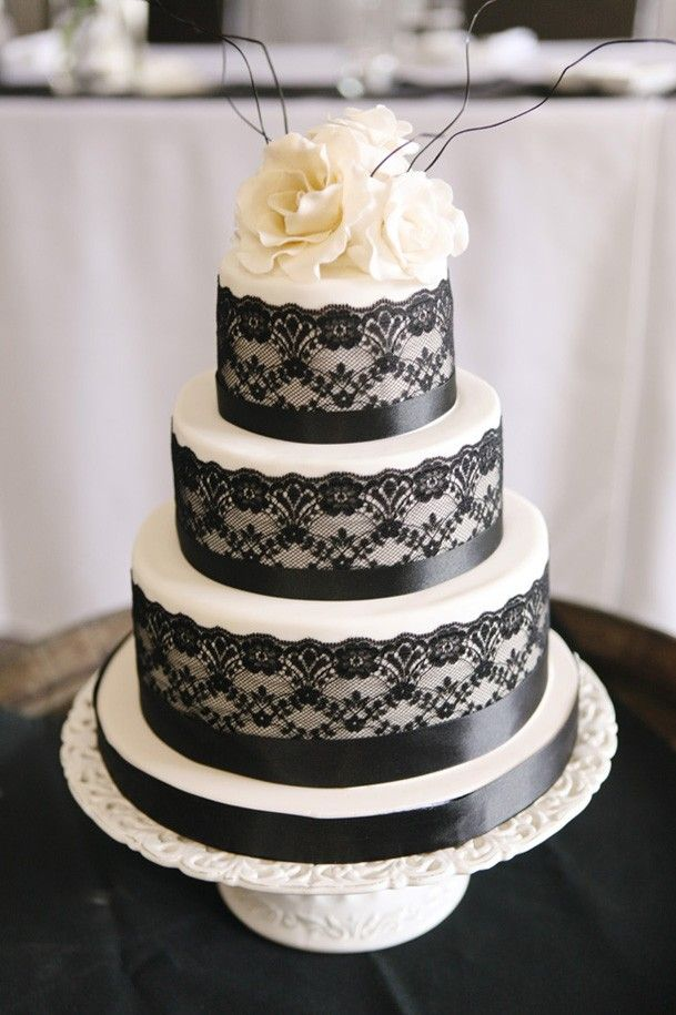 Stunning black lace wedding cake (would have the lace be purple or just plain white if I used this one)