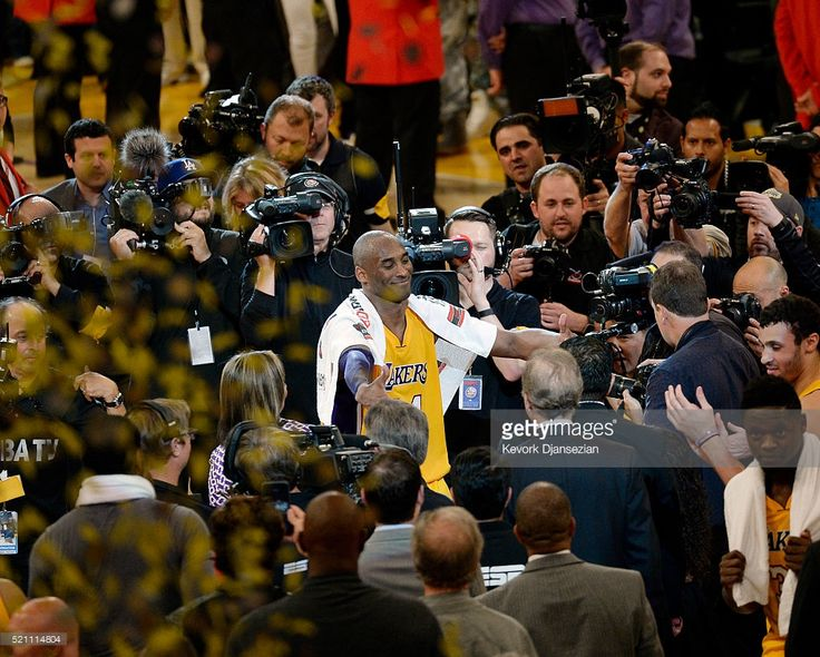 Kobe Bryant #24 of the Los Angeles Lakers reaches out to hugs his children after retiring from basketball and scoring 60 points against the Utah Jazz at Staples Center on April 13, 2016 in Los Angeles, California. Bryant played his last game as a Laker and retired from basketball.