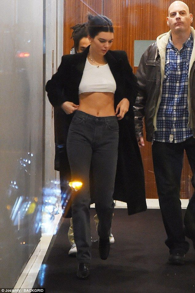 Kendall Jenner was spotted heading to dinner at Carbone in New York City while flashing her flat stomach and major underboob on Friday with pal Luka Sabbat