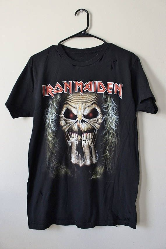 This shirt is a one of a kind, each shredded shirt is different. This one is a cool Iron Maiden Eddie tee, all cotton. It has subtle shredding around the collar, sleeves and bottom hem. Heres your info on it - - Size Medium, check measurements please - Across chest flat, pit to pit - 20 (40 around) - Shoulder seam down - 28 Were happy to acid wash/bleach this tee for a minimal fee, usually an extra $1, and we can do it same day. If you need more info or have any questions, just ye...