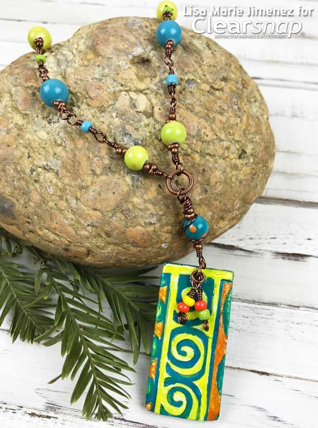 Learn to make this colorful Aztec Pendant using air dry clay and Colorbox Colorique line by Lisa Marie Jimenez. Full tutorial available.