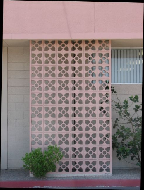 Pink concrete wall - allows light/air flow as well as privacy