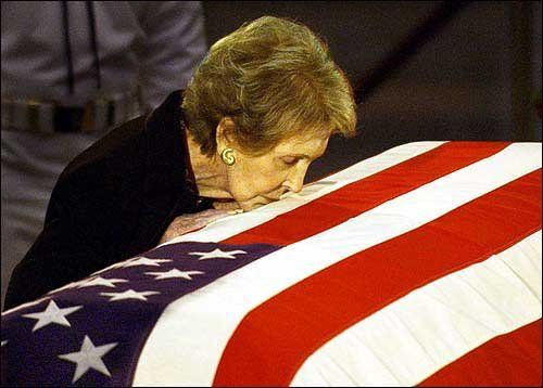 Nancy Reagan giving a kiss to the coffin of her husband of 52 years, Ronald Reagan, during his funeral on June 7, 2004.