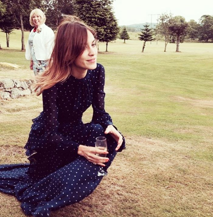 Alexa Chung wears a long sleeve polka dot dress