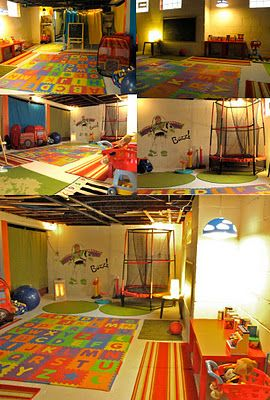 basement playroom. lots of whitewash, rugs, a space heater and buzz lightyear mural! perfect play space for the cold winter months.