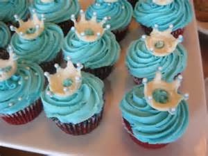 Cupcakes with crown toppers.