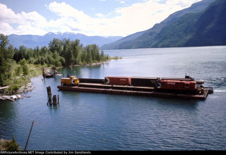 CP Car barge at Rosebery, BC Description: The northbound Nakusp wayfreight aboard barge and tug Iris G docks at Rosebery on Slocan Lake where it will unload and continue on the isolated Kaslo branch to Nakusp. Photo Date: 7/19/1974 Location: Rosebery, BC Author: Jim Sandilands Categories: Scenic,Action Locomotives: CP 8726(H-16-44)