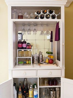 Repurpose your old TV cabinet as a hideaway bar, suggests REDBOOK reader and organizing specialist Grace Brooke. Here, she installed inexpensive hanging glass racks and used three-tiered stacking shelves and trays to maximize the vertical space inside the cabinet.