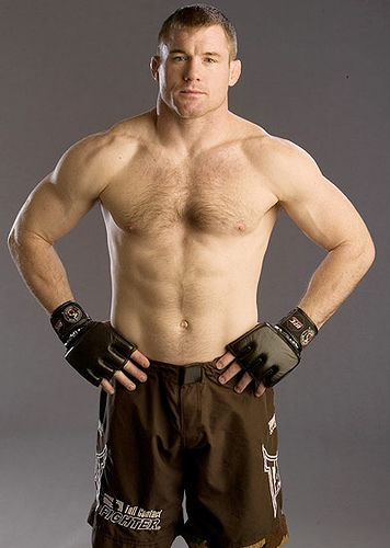 Matt Hughes - Olympic Wrestler   world Champion MMA fighter * yeah,he could probably kick your heart in two.