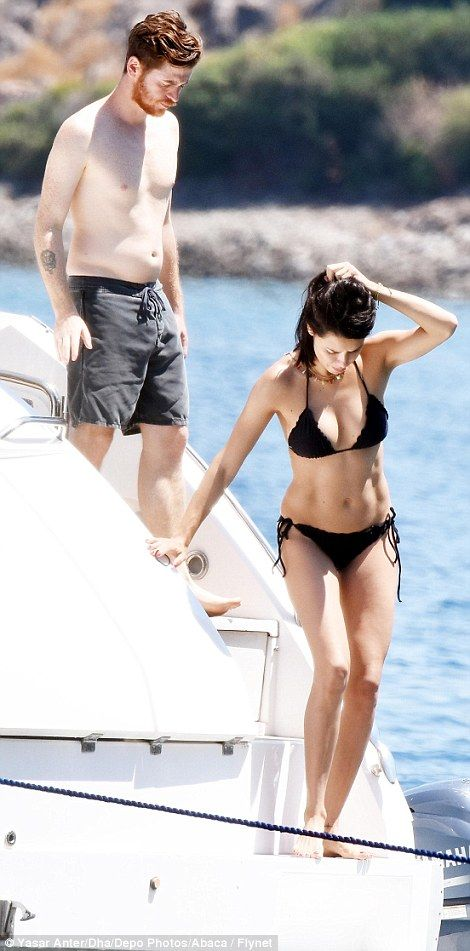 Smitten: Adriana Lima, 36, stripped down to her bikini to join a day out at sea on board a luxury yacht with her new boyfriend Metin Hara in Bodrum, Turkey on Friday