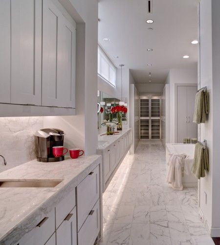 The master bath has two closets at each end, a small kitchen, full-size tub, walk-in shower, toilet area and a double vanity. Also accessible from the master bath is a large laundry room complete with a fold-down ironing center.