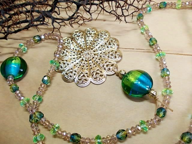 Summer flower...pendant with metal gold plated flower & glass beads in teal, green, blue, yellow & brown colours <3