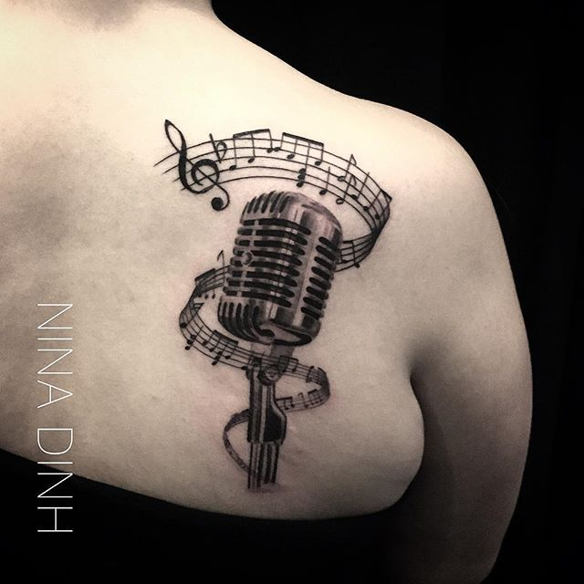 Charming microphone tattoo by Nina Dinh.