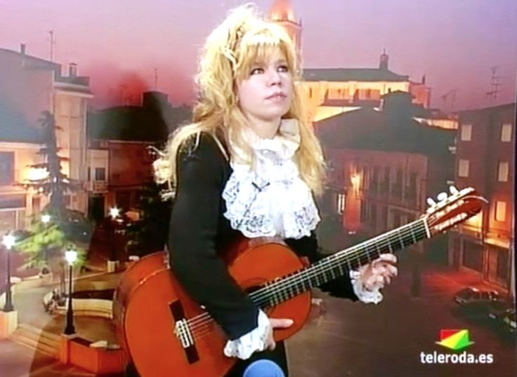 "Flamboyant virtuoso Galina Vale playing live on Spanish TV . Excellent!! ""left hand solo"" not on electric but on acoustic guitar, amazing, I have never have heard this technique before."