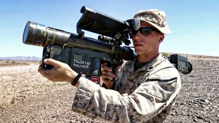 A U.S. Marine Corps Instructor from 2nd Low Altitude Air Defense Battalion (2nd LAAD) explains how to fire an FIM-92 Stinger missile. Members of the 2nd LAAD...