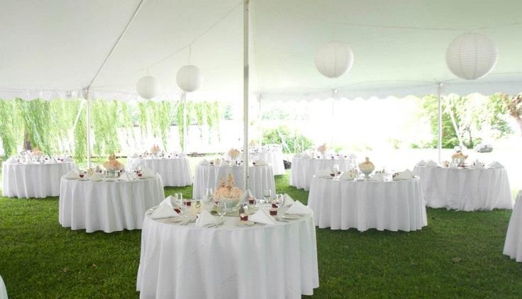 wedding reception tables with pretty milk glass flower centerpieces 6/2011