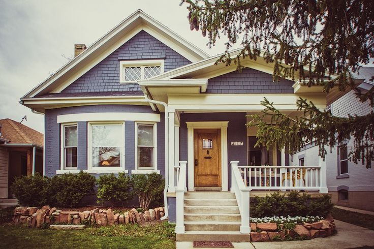 Love this vintage home! Just look how cute that little front porch is!