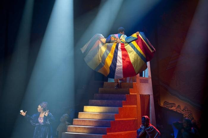 "Joseph (Sydney James Harcourt) shows off his coat of many colors during a fashion show scene from Dallas Theater Center's production of Andrew Lloyd Webber's ""Joseph and the Amazing Technicolor Dreamcoat"" on June 26, 2012."
