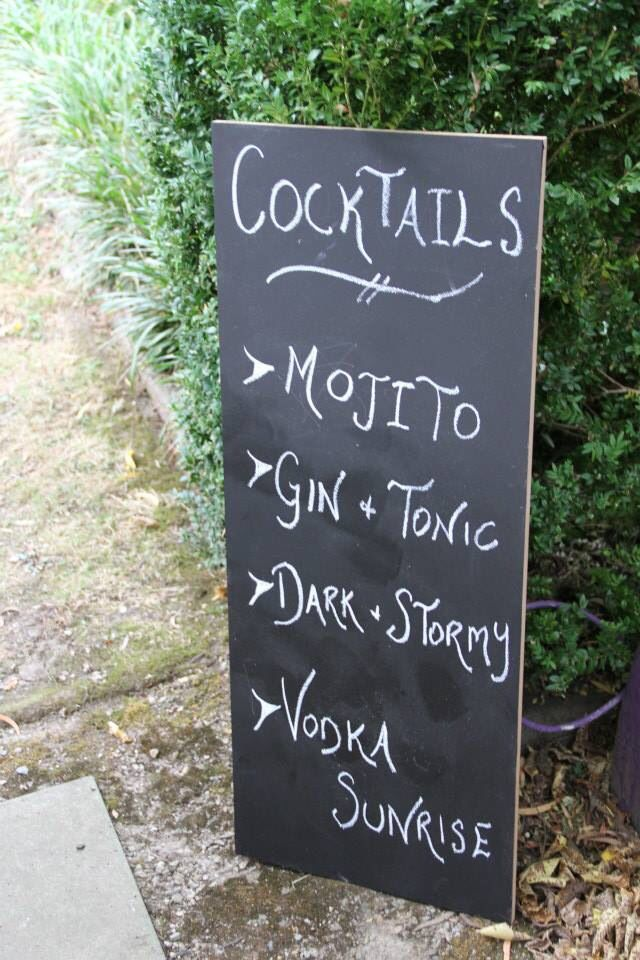 Cocktail menu!  I painted this wooden board with chalk board paint and listed our cocktails we were serving. it gave an exciting touch to all our guest who were welcomed to our party with a selection of cocktails!