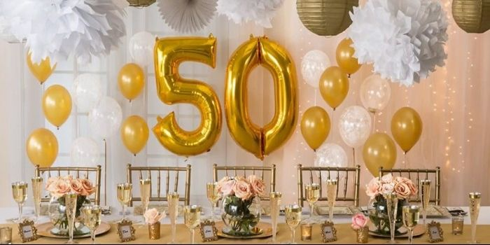 Yellow And White Balloons Near A Table Set Up For A Festive 50th Wedding Anniversary Decorations 50th Anniversary Decorations Wedding Anniversary Decorations