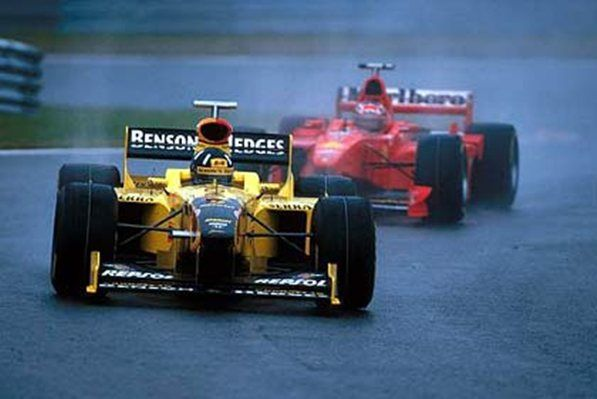 Spa, August 1998: Race winner Damon Hill holds off the Ferrari of Michael Schumacher early in the Belgian Grand Prix.