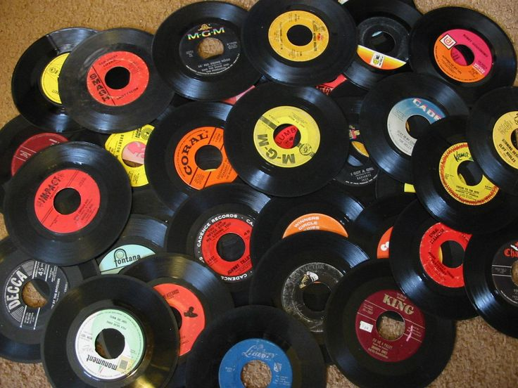 45s vinyl records...they came in paper sleeves.