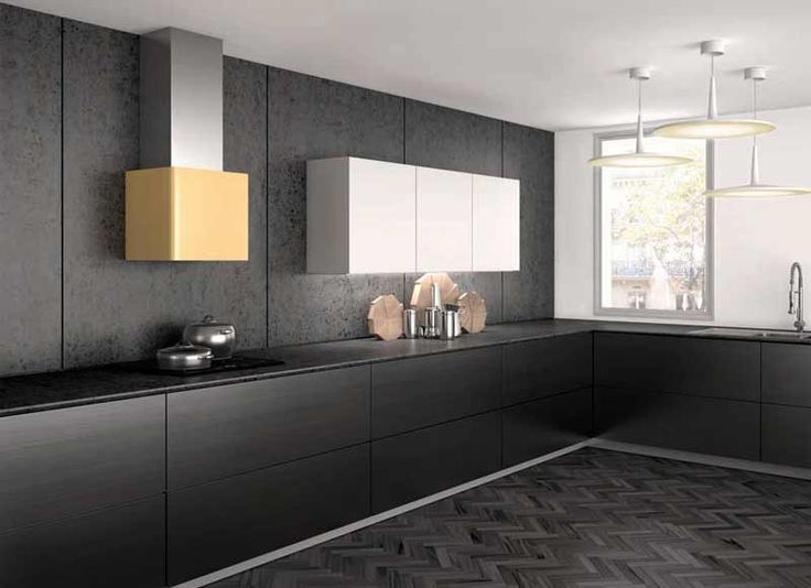 Marked by the contrasting stainless steel of the flue, Lithos distinguishes itself for the careful finish of its smoothed corners, giving it an absolutely smooth and harmonious look. The even light of 2 spotlights, positioned within the body of the hood, lights up the hob to perfection.