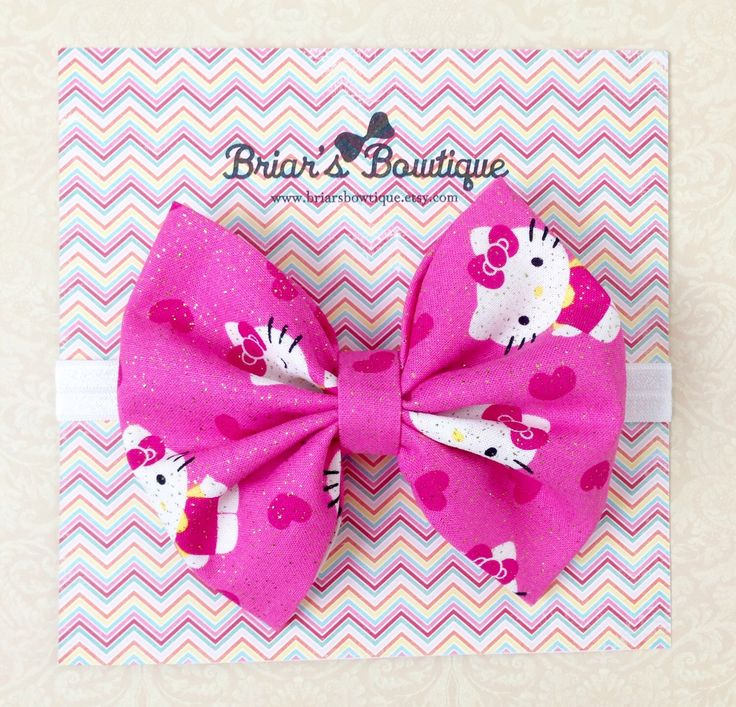 Hello Kitty bow; Pink Hello Kitty fabric bow; Pink, white, and gold bow headband or clip; Hello Kitty birthday party; baby, toddler, or girl by BriarsBowtique on Etsy https://www.etsy.com/listing/242525267/hello-kitty-bow-pink-hello-kitty-fabric