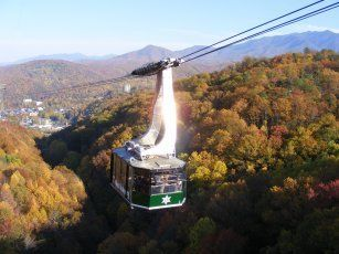 Ober Gatlinburg Aerial Tramway- One of America's Largest Aerial Tramways departs regularly from downtown Gatlinburg, going directly to the Ski Resort and Amusement Park. The two 120 -passenger counter-balanced cars provide an experience for all ages, from the young to the young at heart. The convenience of parking your car downtown and taking the tram is just one of the things we do at Ober Gatlinburg to make your experience a pleasant one.