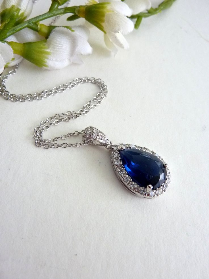High Quality Large Sapphire Blue Peardrop Cubic Zirconia with Multi Round CZs Necklace. $36.00, via Etsy.