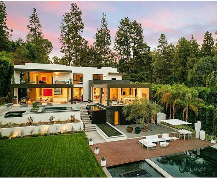 The scenic beauty is complimented by this lavish #architecture & outstanding #design. The combination of natural elements and a scintillating structure comes together harmoniously. Shared via  #luxuryliving #luxuryfurniture #designers #architecture #design #luxuryhomes #interiorstylist #designerfurniture #designerhomes #house #mansions #gardens #pools #architechts #archi #inspo #deco #homes