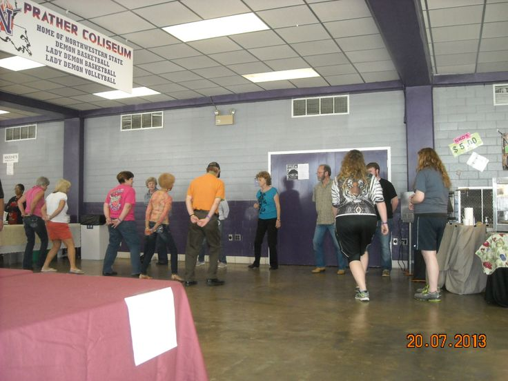 Dancing on the west concourse; 34th Annual Natchitoches-NSU Folk Festival; 2013