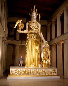 Parthenon (Nashville) re-creation of Athena statue is the focus of the Parthenon just as it was in ancient Greece. Building is a full-scale replica of the Athenian original;statue of Athena within is a reconstruction of the long lost original: she is cuirassed & helmeted, carries a shield on her left arm & a small (6 ft) statue of Nike (Victory) in her right palm & stands 42 ft high, gilt with more than eight lbs of gold leaf; an equally colossal serpent rears its head between her & her…