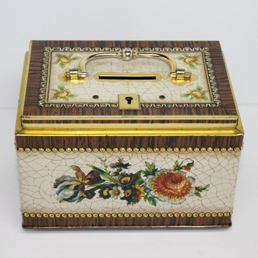 Vintage bank lock box tin with opening lid and handle.  No key.  Print on tin is done in a floral over faux cracked paint with woodgrain edging and raised faux brass tacks.  I don't know the maker but there is a tiny logo with 471/7.  The lid opens and closes tightly and still has the locking mechanism.  Dent in front with other general wear such as scratches, dings, paint loss giving the box some nice vintage characteristics.  Silver tin color on inside and bottom with gold color tr...
