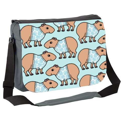 Capybara Messenger Bag by zoel  A repeat pattern featuring a cute capybara wearing a tropical blue pineapple shirt.  capybara, guineapig, guinea, pig, cavy, cute, vector, blue, pineapple,