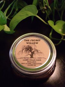 Amber Sugar Scrub -- Romance by The Secret Willow -- an Apothecary for Mind, Body and Spirit. $14.50. Amber Sugar. Certified Organic Herbs/Flowers. Essential Oils. All Natural Ingredients. Our Amber Sugar Scrub contains a luxurious combination of ingredients which provides an exfoliating, moisturizing and healing experience for your skin.     Exfoliation is the key to glowing, healthy skin. Using our exfoliating body sugar scrub can help you achieve smooth ski...