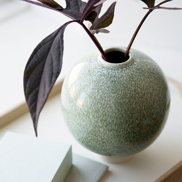 This sculptural vase has a heavy and colourful glaze, which creates an exciting contrast against the delicate ceramics.