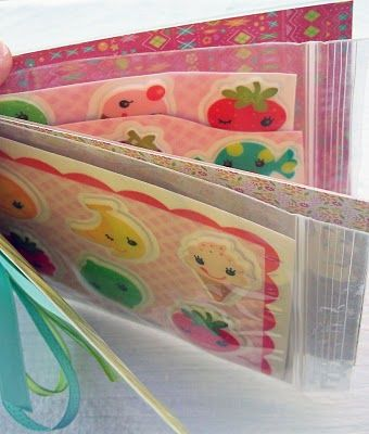 Sticker book using laminated fabric  using paper and plastic baggies