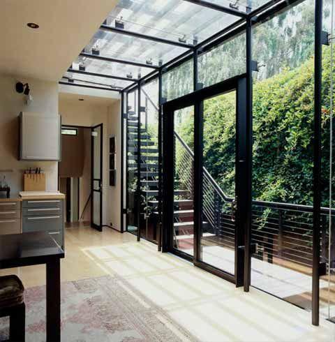 Modern glass cube extension