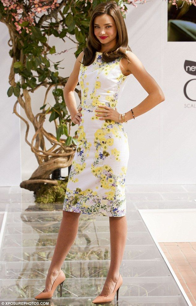 In full bloom! Miranda Kerr displays her famous figure in a form-fitting floral shift dress as she promotes a hair care product.