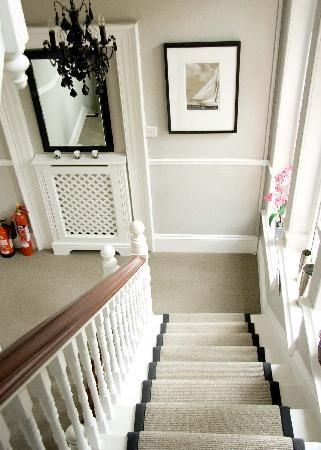 Staircase.  Find out how to get the stair runner round corners.  Like the painted balusters and stained handrail.